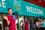 Virgin Australia cabin crew greeting arriving delegates at 2014 Australian Tourism Exchange in Cairns
