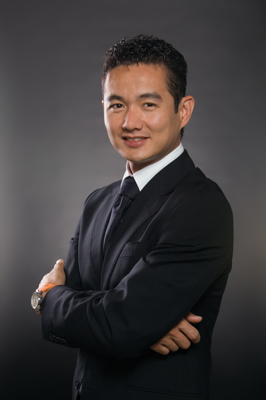 Portrait of Asian business executive with grey background, Cairns