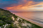 Aerial view of sunrise clouds above tropical beach at Wangetti, near Cairns