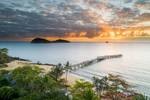 Sunrise aerial view of jetty with island beyond, Palm Cove, Cairns