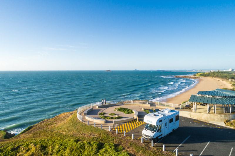 Aerial view of camperavan parked overlooking Lamberts Beach, Mackay