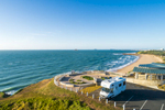 Aerial view of camperavan parked overlooking Lamberts Beach, Mackay