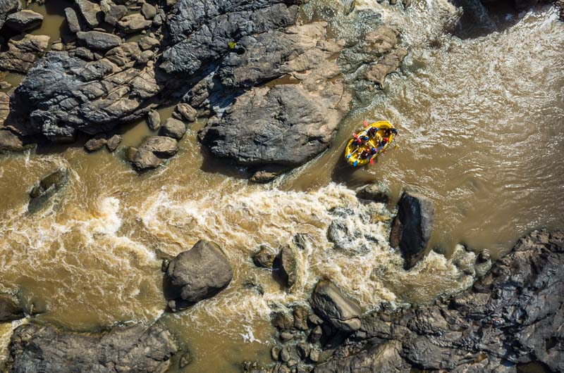 Aerial view of white water rafters paddling down the Barron River, Cairns