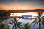 Aerial view of the sun setting behind Sugar Wharf and Dickson Inlet, Port Douglas