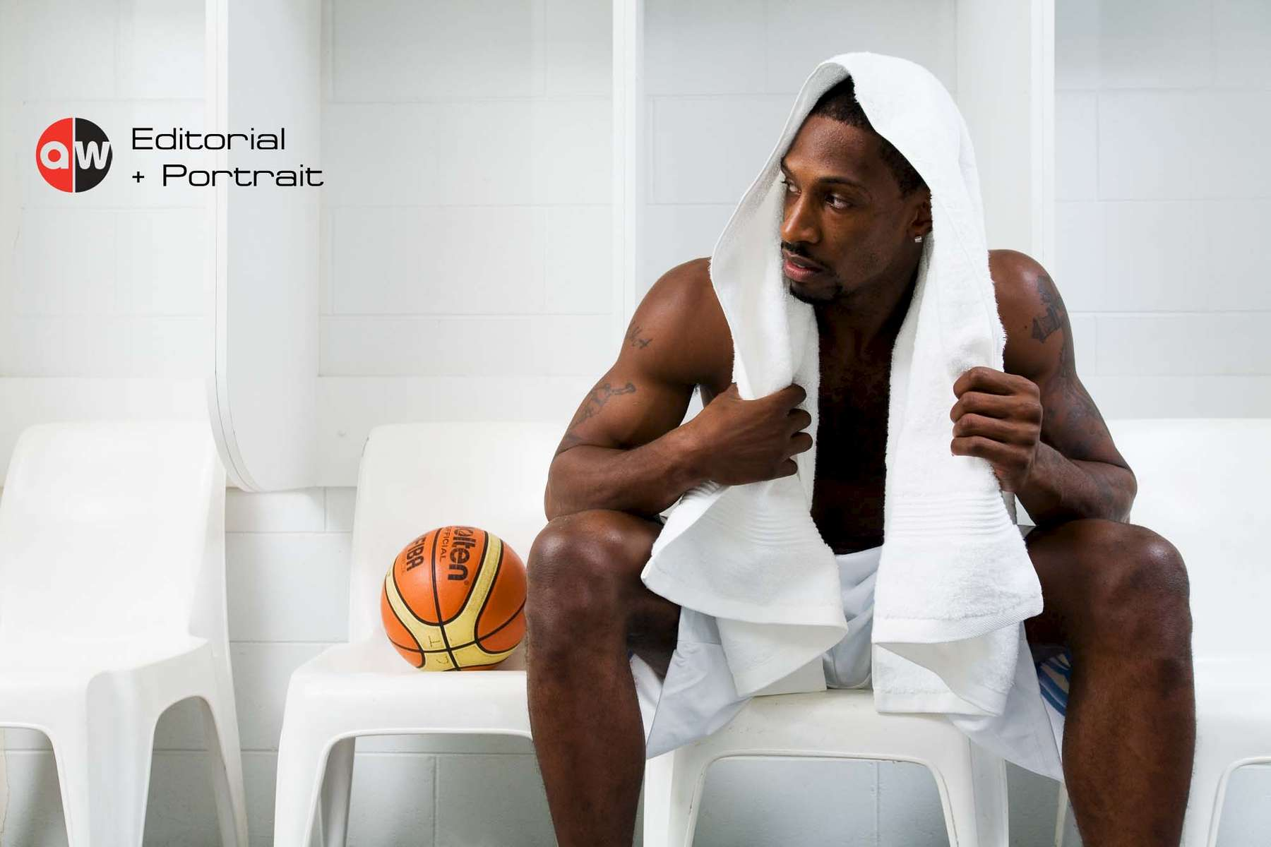 Portrait of basketball player Larry Abney sitting in locker room by professional photographer Cairns