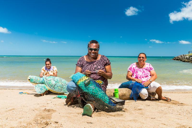 Three Erub Island women working on art pieces made from ghost nets, Torres Strait