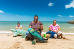 Three Erub Island women working on art pieces made from ghost nets, Torres Strait