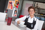 Portrait of female business owner relaxing in cafe, Cairns