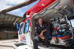 Portrait of male emergency rescue worker sitting in helicopter