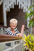 Portrait of female business owner standing on steps of building, Cairns