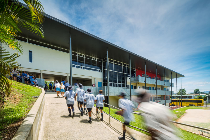 Blurred movement image of students walking up to school library