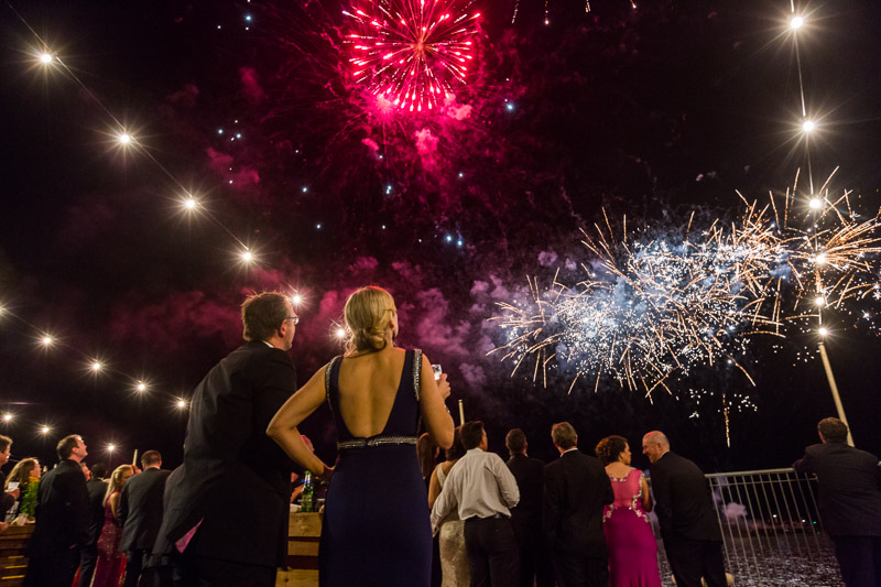 Couple watching fireworks display at Cairns Amateurs Ball 2015 on the waterfront