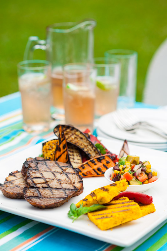 Platter of barbequed food and summer drinks as part of a food photography shoot for Reef Catering in Cairns