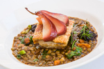 French dish of pork belly with lentils and poached pear at C'est Bon Restaurant by food photographer, Cairns