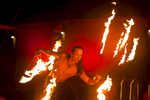 Male fire dancer performing at Ausure 2012 Conference in Cairns
