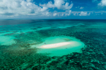 Aerial view of Vlassof sand cay surrounded by fringing reef, Great Barrier Reef Marine Park