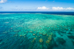 Aerial view of coral formations of the Great Barrier Reef Marine Park, Cairns