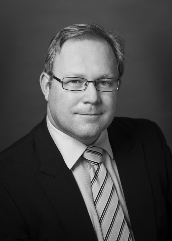Black and white headshot of a male financial services advisor, Cairns