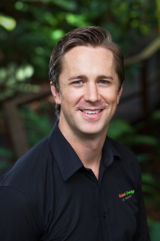 Corporate headshot of renewable energy director shot with garden background, Cairns