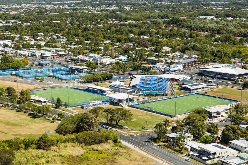 Aerial view of sporting precinct including hockey fields and swimming pool, Cairns