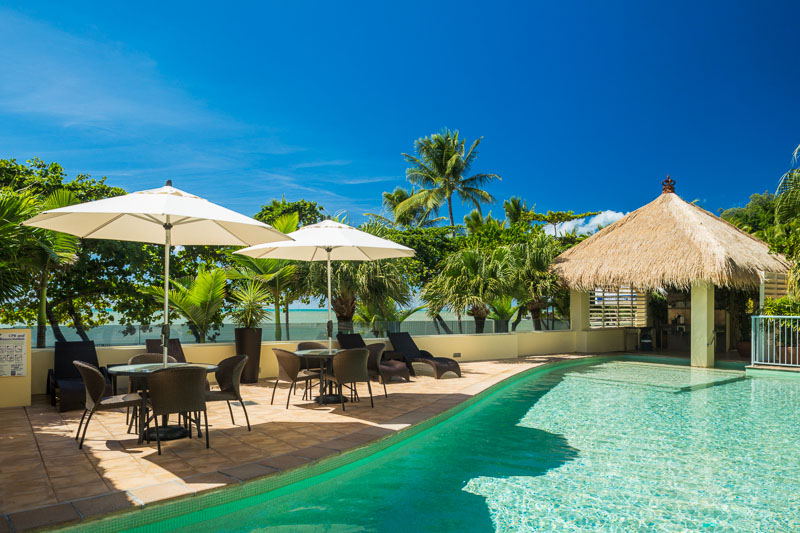 Pool and sun chairs at Sea Change Beachfront Apartments