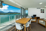 Apartment dining area overlooking the harbour at Cairns Harbour Lights