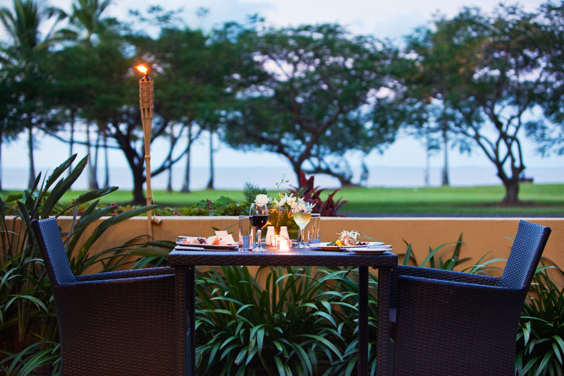 Dining table set for two overlooking Esplanade, Cairns