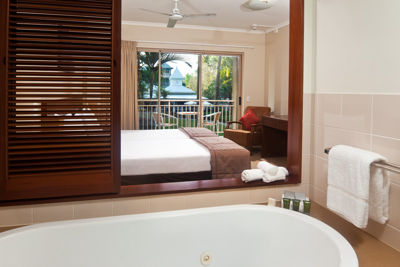 View of bathtub through to hotel bedroom at Mantra Amphora, Palm Cove.