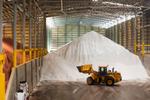 Bulldozer next to a stockpile of fertilzer in a warehouse, Cairns