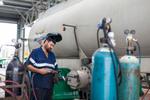 A welder preparing his equipment for work on a tanker, near Innisfail