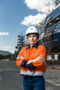 Image of a female safety officer in front of a ship in drydock, Cairns