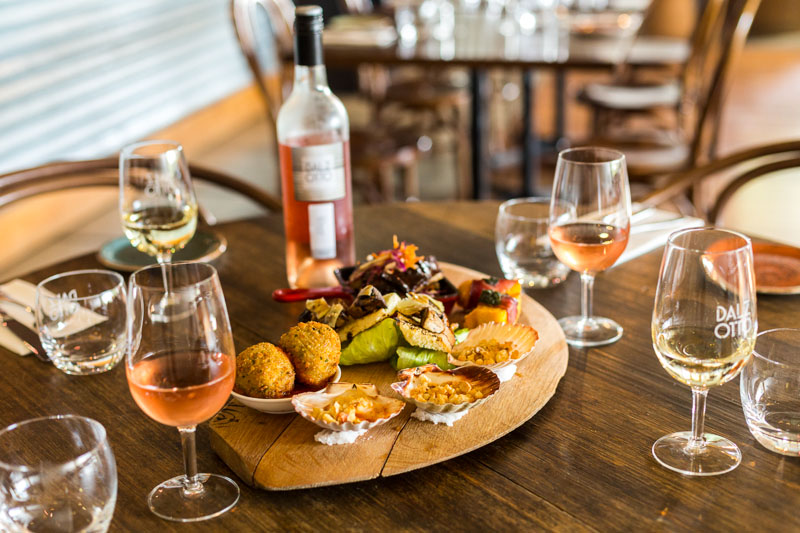 A tasting platter and wine glasses on a table at Dal Zotto Winery