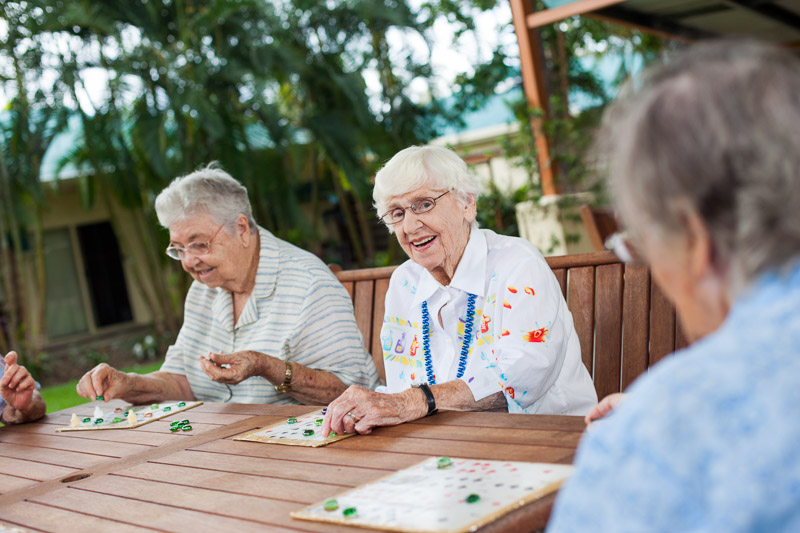 Female elderly residents enjoying a game of bingo