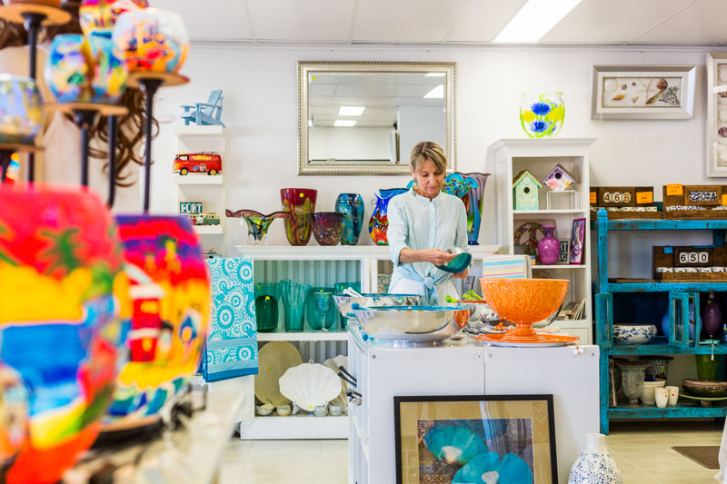 Woman looking at homewares in a boutique store