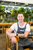 Portrait of chef Nick Holloway sitting in restaurant interior