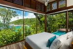 Villa bedroom overlooking the beach at Bedarra Island Resort