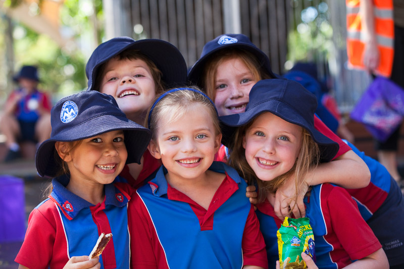 Group photo of smiling schoolchildren at a primary school