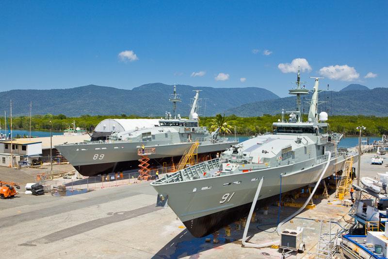 Two Navy patrol boats in drydocks at a Cairns shipyard