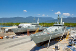 Two Navy patrol boats in drydocks at a Cairns shipyard