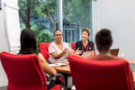 A business studies student in an office meeting at Cairns campus of TAFE Queensland
