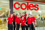 Group photo of Coles Earlville service team at Stockland Shopping Centre in Cairns