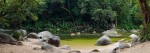 Image of clear waters and boulders at a popular swimming spot in Mossman Gorge