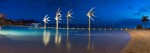 Panoramic image of fish sculpture in the Cairns Esplanade Lagoon at twilight.
