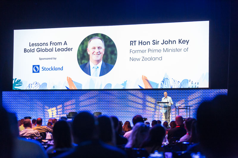Sir John Key speaking on stage at The Property Congress 2018 in Darwin