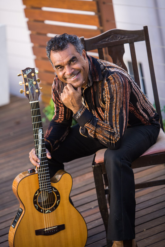 Portrait of aboriginal musician David Hudson with guitar