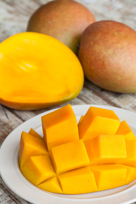 Fresh mangoes sliced and ready for eating on a plate, Mareeba
