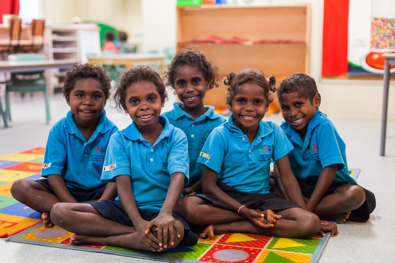 Group of young aboriginal students smiling in the classroom, North Queensland