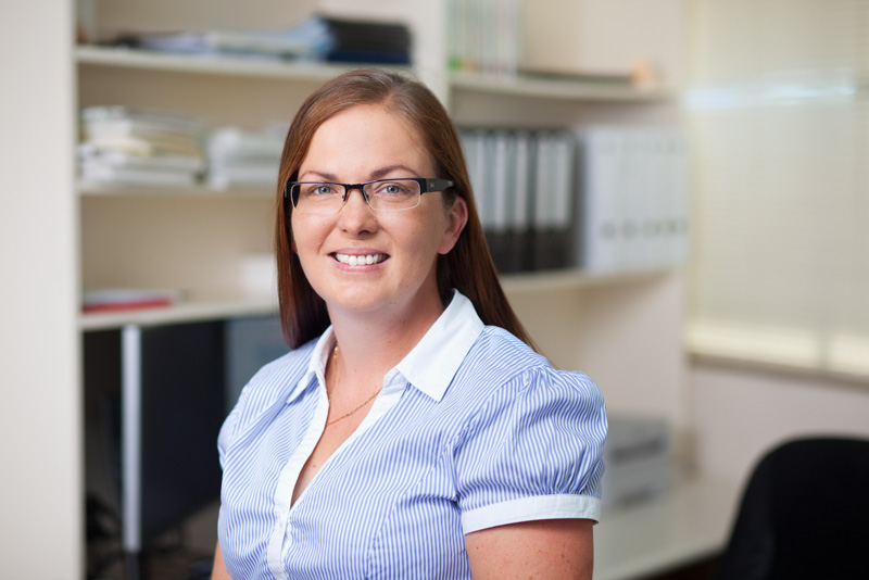 Headshot of a female accountant with office background, Cairns