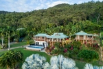 Aerial view of residential property backed by forested hills at Killaloe, Port Douglas