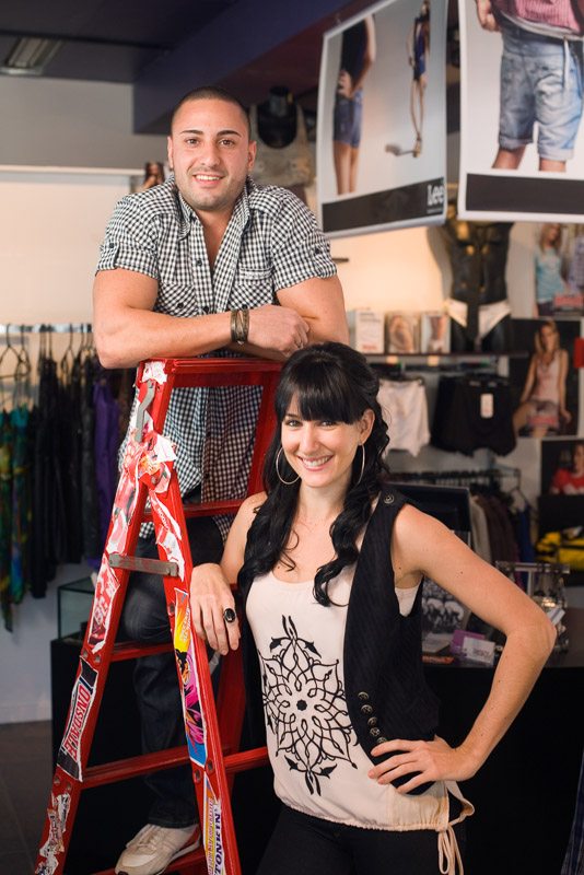 Portrait of young business couple in fashion store, Cairns